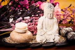 Soaps and buddha statue with flowers spa concept Stock Images