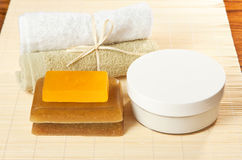 Soaps, cream and towels ready for spa treatments. Aromatic soaps, moisturizing cream and fresh towels ready for spa treatments Royalty Free Stock Photo