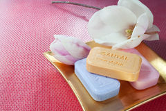 Soaps and flowers Stock Image