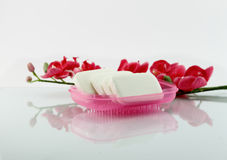 Soaps and flowers Royalty Free Stock Photos