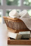 Soaps and natural basket. Soaps,towels and basket with a blurred background Royalty Free Stock Images