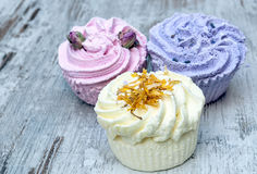 Soaps shaped cupcake. Surrounded by rustic backgrounde Royalty Free Stock Photography