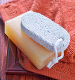 Soaps. And towel on a table Royalty Free Stock Photos