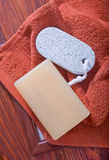 Soaps. And towel on a table Stock Image