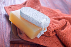 Soaps. And towel on a table Stock Photos
