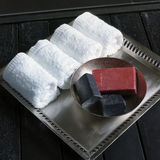 Soaps and towels. In the bath Royalty Free Stock Photos