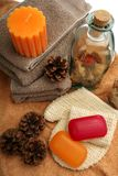 Soaps, towels, candles and pine cones Royalty Free Stock Images