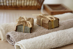 Soaps with towels and natural basket. Soaps,towels and basket with a blurred background Royalty Free Stock Image