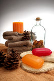 Soaps, towels and pine cones Royalty Free Stock Images