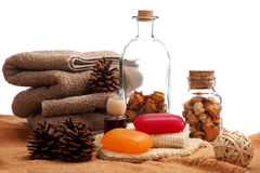 Soaps, towels and pine cones placed on a towels Royalty Free Stock Photography