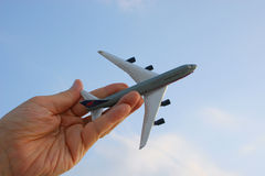 Soar in the Sky. Hand holding model plane against the sky Royalty Free Stock Image