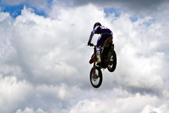 Soaring. Motorbike stunt riders entertain the public with high flying acrobatics at the annual Republic of Texas biker rally, held every year the week after Stock Image