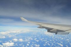 Soaring above. Clouds as seen from an airplanes window Stock Images