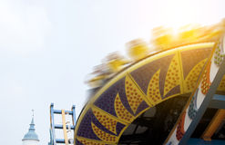 Soaring across the skies in amusement park Stock Images