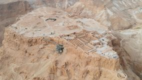 Soaring aerial 4K view MASADA, ISRAEL. Filmed flying drone. flying around Masada, an ancient Jewish fortress in the. Israeli desert. Israeli soldiers on top of stock footage