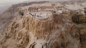Soaring aerial 4K view Masada, Israel. Filmed flying drone. flying around Masada, an ancient Jewish fortress in the