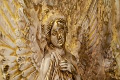 Soaring angel with a hand on his chest stock photos