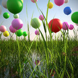 Soaring balloons in a field of grass 3d illustrate. Abstract colorful composition including a pond, a field of long grass and balloons Stock Image
