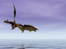 Soaring Dragon. Dragon soaring low over the sea Royalty Free Stock Photography