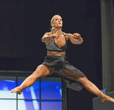 Soaring Fitness Routine. Canadian Meghan White makes for a pretty picture as she soars in the air during her pro fitness competition at the 2017 IFBB Toronto Stock Photography