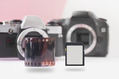 Soaring Memory Flash Card and 35 mm Negative Film Roll with DSLR on Back royalty free stock photos