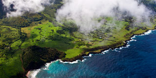 Soaring over tropical island. Banner view from a motorized glider over the Hana coast of eastern Maui, Hawaii Stock Photo