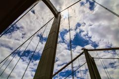 Soaring towers of a suspension bridge against sky Royalty Free Stock Photography