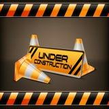 Sob a barreira da construção com cones da estrada Imagem de Stock