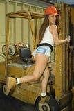 Sob a construção com uma dama quente Imagem de Stock Royalty Free