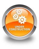 Sob o botão redondo alaranjado lustroso da construção (ícone das engrenagens) Fotografia de Stock Royalty Free