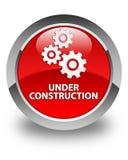 Sob o botão redondo vermelho lustroso da construção (ícone das engrenagens) Imagens de Stock Royalty Free