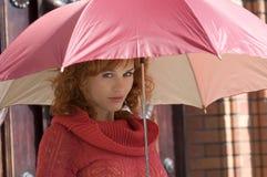 Sob o guarda-chuva Fotografia de Stock Royalty Free