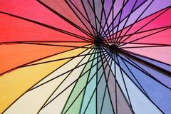 Sob o guarda-chuva colorido molhado Fotos de Stock Royalty Free