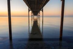 Sob o nascer do sol do molhe Imagem de Stock Royalty Free