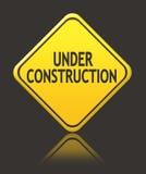 Sob o sinal da construção Fotografia de Stock