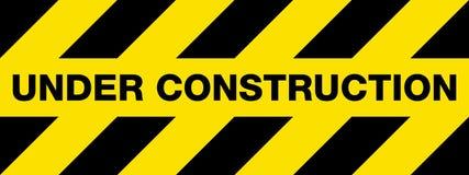Sob o sinal da construção Imagens de Stock Royalty Free