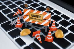 Sob o sinal da construção no teclado Imagens de Stock Royalty Free