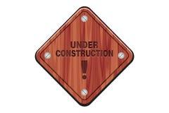 Sob o sinal da construção - sinal de madeira Imagem de Stock Royalty Free