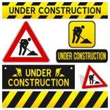 Sob os sinais da construção ajustados Fotos de Stock Royalty Free