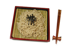 Soba. Traditional Japanese noodles in a specific dish with chopsticks over white Stock Photography