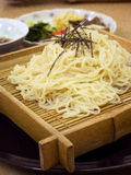 Soba on bamboo plate Royalty Free Stock Photography