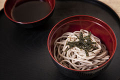 Soba. Japanese noodle in black dish Royalty Free Stock Images