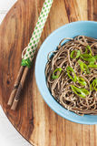 Soba noddles in the bowl with chopsticks. Top view Stock Image