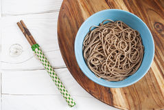 Soba noddles in the bowl. With chopsticks. Top view Royalty Free Stock Photography