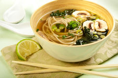 Soba Noodle and Kale Soup. Black Tuscan Kale and Soba noodle in a vegetable broth with mushroom Stock Photos