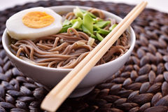 Soba noodle soup. With boiled egg and green onion. Selective focus on the noodles Stock Images