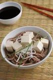 Soba noodle soup with tofu and daikon radish Stock Photos