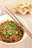 Soba noodle soy sauce. Soba noodle with ginger garlic soy sauce garnish with parsley and sesame seeds Royalty Free Stock Image