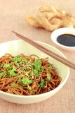Soba noodle soy sauce. Soba noodle with ginger garlic soy sauce garnish with parsley and sesame seeds Stock Photo