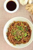 Soba noodle soy sauce. Soba noodle with ginger garlic soy sauce garnish with parsley and sesame seeds Royalty Free Stock Photography